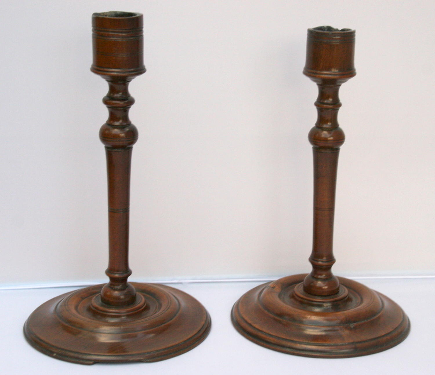 A fine and rare pair of English Candlesticks, Cherry wood, early 18th