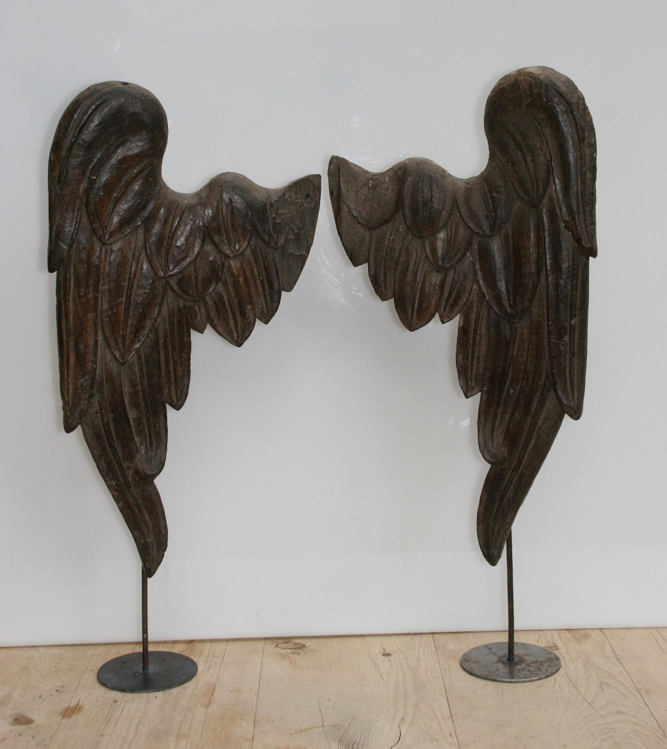 A pair of carved wooden Angels wings  19th century