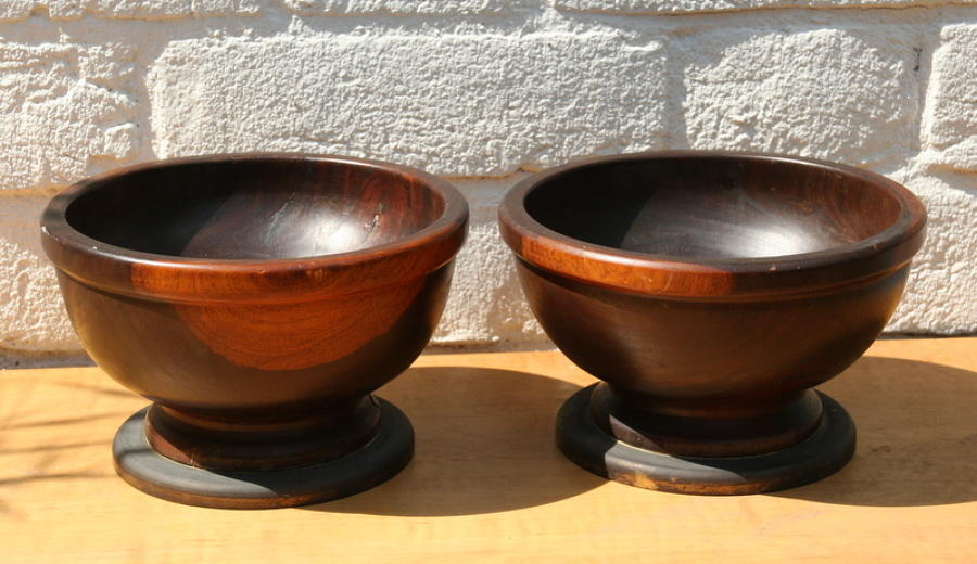 A pair of large Lignum Vitae Bowls on Bronze Stands / foot