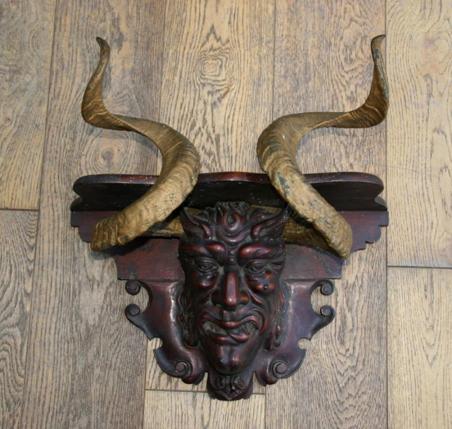 Carved wooden Devil's head