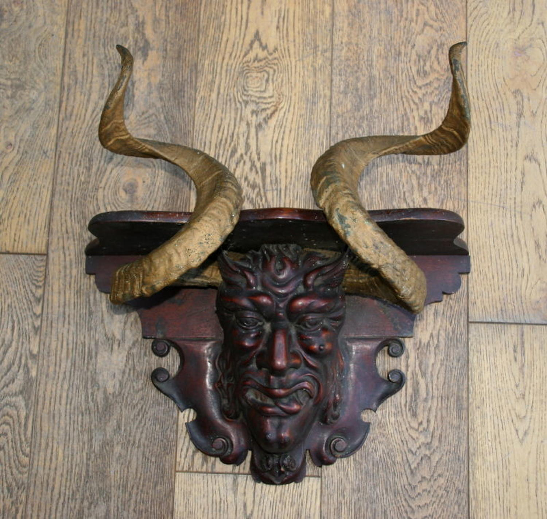 Carved wooden Devil's head