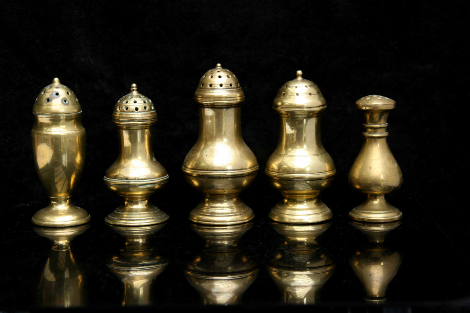 A Collection English Brass 18th century Muffineers