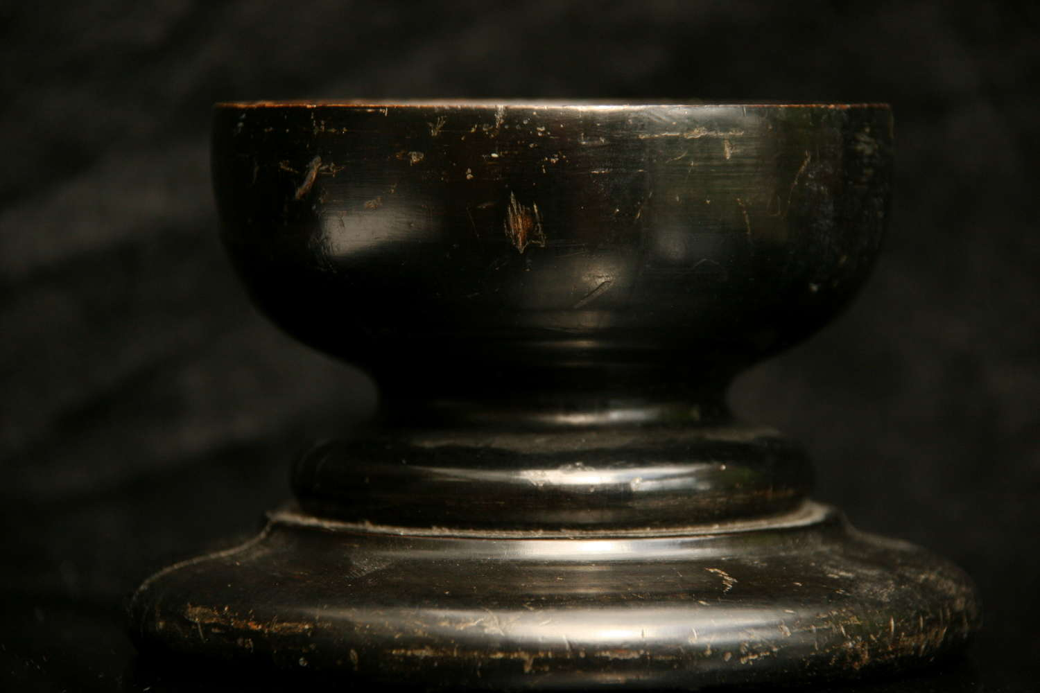 An English early 19th century ebonised Treen Salt