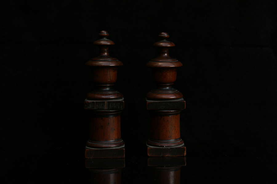 A pair of 19th century decorative wooden chimney ornaments