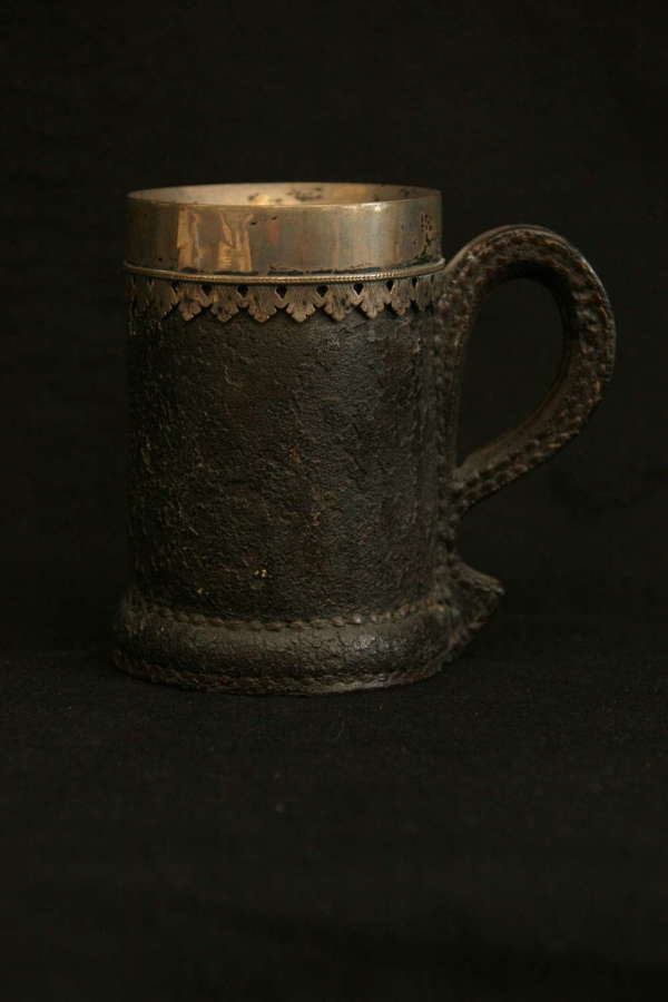 Late 17th leather Tankard silver rim.